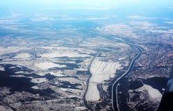 View from plane illuminator on winter city edge Stock Images
