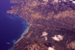 View from the plane of the mountains and sea Royalty Free Stock Photography