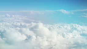 View from the plane at moving snow white clouds. Sky background. The Heaven. Flying on an airplane among the clouds. Tranquil background stock footage