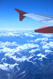 View from the plane over snowy mountains Stock Photos
