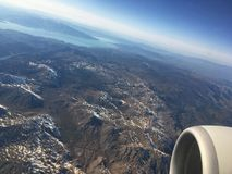 View from the plane to the Mediterranean part of Turkey. The area of Isparta, a lot of mountains, snow on the tops, spring, lake with blue water, turbine stock photography