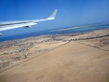 View from the plane to the resort town on the red sea. Desert and roads stock photos