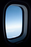 View from plane window. Clear blu sky seen through an airplane window seat Stock Photos