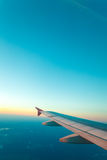 View from plane window. Clear sky. Adventure, travel, transport concept. View from plane window at clear sky and wing Royalty Free Stock Photos