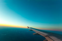 View from plane window. Clear sky. Adventure, travel, transport concept. View from plane window at clear sky and wing Stock Image