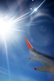 View from Plane. Wing of an airplane - view into the sun Stock Photos