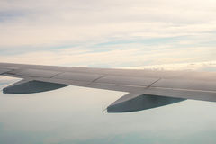 A view from the plane on the wing and clouds Stock Image