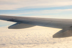 A view from the plane on the wing and clouds Royalty Free Stock Image