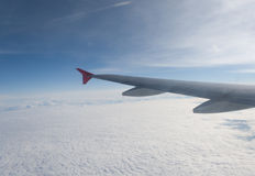 A view from the plane on the wing and clouds Royalty Free Stock Photos