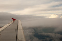 View from the plane on the wing and clouds. Royalty Free Stock Photos