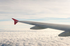 View from the plane on the wing and clouds. Stock Photography
