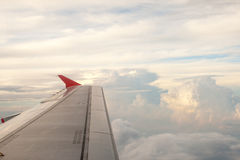 View from the plane on the wing and clouds. Stock Image