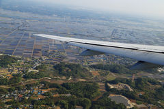 View from a plane on wing and on rural Royalty Free Stock Photography