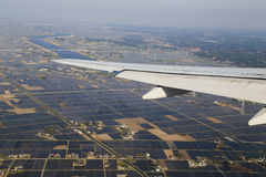 View from a plane on wing and on rural Royalty Free Stock Photos