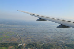View from a plane on wing and on rural Stock Images
