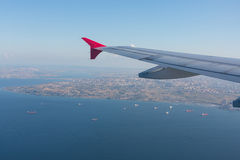 View from the plane on the wing sea Royalty Free Stock Photography