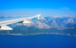 View from the plane on the wing sea and land Stock Photos