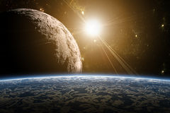 A view of planet earth, moon and sun. Royalty Free Stock Images