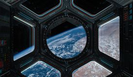 View of planet Earth from a space station window 3D rendering el. Window view of planet earth from a space station in space 3D rendering elements of this image Royalty Free Stock Photography