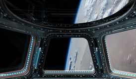 View of planet Earth from a space station window 3D rendering el. Window view of planet earth from a space station in space 3D rendering elements of this image Royalty Free Stock Image
