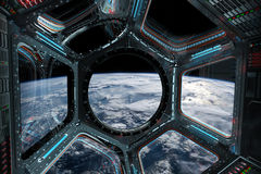 View of planet Earth from a space station window 3D rendering el. Window view of planet earth from a space station in space 3D rendering elements of this image Royalty Free Stock Photos