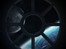 View of planet Earth from a spaceship cabin Stock Photography