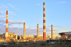 A view of the plant with high chimneys.  Stock Photo