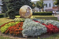 View of plants, flowers and figures in the city park in historical city center of Yaroslavl, Russia. Royalty Free Stock Photography