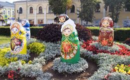 View of plants, flowers and figures in the city park in historical city center of Yaroslavl, Russia. Stock Photos