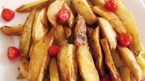 View of a plate of potato wedges stock video footage