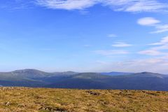 View from the plateau to the mountains and beautiful blue sky. Panoramic view from the mountains of the Northern Urals stock image