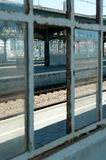 View on a platform. A look at the next platform and track through a missing piece of glass Royalty Free Stock Photo