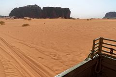 View from the platform of an off-road vehicle to the ripple marks in the desert sand of Wadi Rum, Jordan stock photos