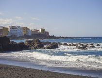 View on Playa Jardin beach with blue sea horizon, rock and color stock photography