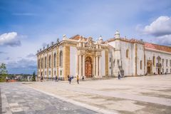 View of plaza of University of Coimbra, with tourists and building of the Joanina Library, in Coimbra, Portugal. Coimbra / Portugal - 04 04 2019 : View of plaza stock photo