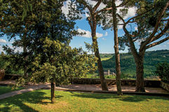 View of a pleasure garden with a stronghold an wooden hills in the foreground at Orvieto. Stock Images