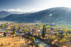 View of Pnuakha Valley with Cloudy Sky, Punakha, Bhutan stock photo