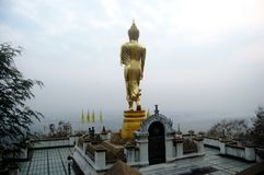 View point and buddha walking statue at Wat Phra That Khao Noi t Stock Images