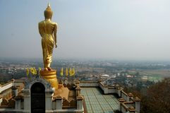View point and buddha walking statue at Wat Phra That Khao Noi t Royalty Free Stock Images