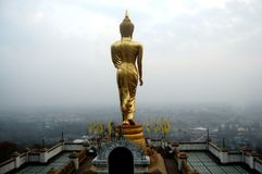View point and buddha walking statue at Wat Phra That Khao Noi t Royalty Free Stock Photography