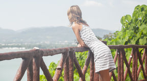 View point. Lady in dress enjoying view from the view point Royalty Free Stock Photo