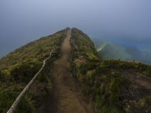 View point Miradouro da Boca do Inferno overlooking the lakes of Sete Cidades, lakes covered by fog mist and clouds. Sao. Miguel in the Azores, Portugal royalty free stock photography