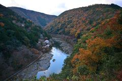 View point of the river and forest in autumn season at arashiyam. A,Japan Royalty Free Stock Photo