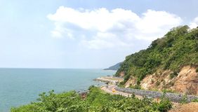 View point. Winding curvy road on edge of mountain and sea view with soft sky on the background at Chanthaburi province ,Thailand Royalty Free Stock Photography
