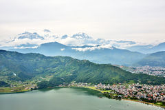 View of Pokhara lake with Annapurna in background, Nepal Stock Photos