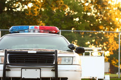 View of police car bumper. Front view of police car with siren and windshield stock photography