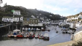 View of Polperro Cornwall South West England UK professional video pan of boats and buildings stock footage