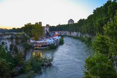 View of Pons Fabricius, Tiber Island and Tiber river from Ponte stock photos