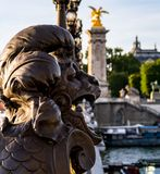 Close-up on a statue of Pont Alexandre lll bridge - Paris, France. royalty free stock images
