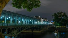 View of pont de Bir-Hakeim night timelapse - a bridge that crosses the Seine River. Paris, France. View of pont de Bir-Hakeim formerly pont de Passy night stock footage
